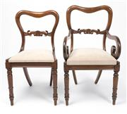 Sale 8518A - Lot 45 - A set of 8 Antique English mahogany chairs C: 1870, (6 & 2 carvers). The waisted backs and carved top rail above drop in seats uphol...