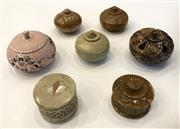 Sale 8436A - Lot 85 - A group of seven assorted stone lidded boxes some with floral decoration.