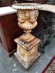 Sale 8917 - Lot 1006 - Two Cast Iron Garden Urns on Stands, the urns with part gadrooned bodies, mask heads & festoons, on tapering plinth with wreaths
