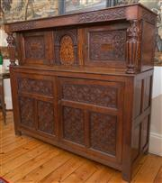 Sale 8435A - Lot 25 - A C17th style carved oak and marquetry court cupboard with centre arcade of bird amongst fruiting branch, with four doors, H 135 x D...