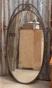 Sale 9060H - Lot 6 - A decorative iron framed mirror of oval form, Height 136cm x width 75cm
