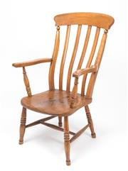 Sale 8518A - Lot 70 - A Georgian antique English high back country armchair in elm and yew wood C: 1820. The top rail with a 4 slat backs flanked by shape...
