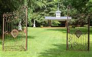 Sale 8677A - Lot 35 - Pair of decorative metal gates H x 264cm, W x 136cm each panel