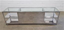 Sale 9157 - Lot 1045 - Chrome based tv unit with glass top (h:50 w:180 d:45cm)