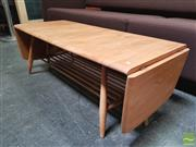 Sale 8435 - Lot 1003 - Good Ercol Blonde Coffee Table with Drop Ends and Magazine Shelf