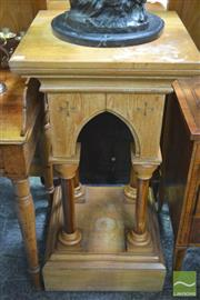 Sale 8317 - Lot 1048 - Early 20th Century Limed Oak & Fruitwood Pedestal, with arcade on turned columns, bearing plaque for C Bull Ltd, Dublin