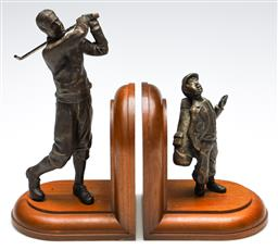 Sale 9246 - Lot 15 - Timber based bookends featuring a golfer and caddy - repair to club (H:24cm)