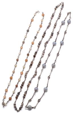 Sale 9115 - Lot 348 - THREE SILVER STONE BEAD NECKLACES; one strung with 6mm round banded agate beads to a scroll clasp, length 70cm, one with 10mm round...