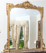 Sale 8435A - Lot 63 - A Victorian gilt gesso mirror surmounted by shell and foliate scrolls, H 165 x W 145cm