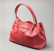 Sale 8499A - Lot 68 - A Tods red leather handbag with drawstring and zippered wallet compartment. Length: c. 40 cm.
