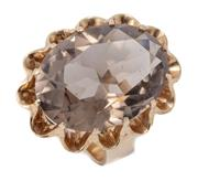 Sale 9012 - Lot 340 - A LARGE RETRO SMOKY QUARTZ COCKTAIL RING; featuring an oval cut quartz of approx. 18.12ct in 9ct gold scalloped basket mount, size J...