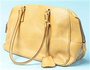 Sale 9090F - Lot 37 - A VINTAGE PRADA TRAPEZE STYLE HANDBAG; in slemon yellow leather with red trim and priping, featuring a bag tag and two large handles