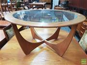 Sale 8451 - Lot 1070 - G-Plan round atmos coffee table with glass top