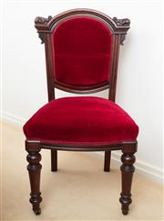 Sale 8908H - Lot 42 - A set of six mahogany dining chairs with red velvet upholstery, carved backs of architectural form, front turned legs on castors, He...