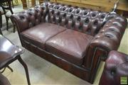Sale 8310 - Lot 1635 - Maroon 2 Seater Chesterfield
