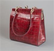 Sale 8499A - Lot 72 - A stylish maroon vintage crocodile skin clutch bag with gilt hardware.