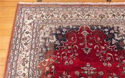 Sale 9190H - Lot 37 - A woollen Persian Kashan carpet with central medallion of russet ground, Length 305cm x 207cm, worn