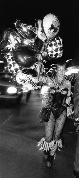 Sale 9082A - Lot 5022 - Sydney Gay and Lesbian Mardi Gras Parade, Oxford Street (1988), 11 x 24.5 cm, silver gelatin, Photographer: Gary McLean