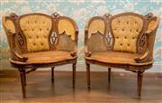Sale 8500A - Lot 38 - A pair of vintage timber & rattan decorative French style tub chairs featuring lovely carved detail, upholsetered backrests & sides...