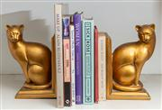 Sale 8761A - Lot 31 - A pair of gilt ceramic feline bookends, together with a small quantity of books including how to develop a bust, Height of bookends...