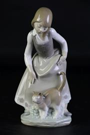 Sale 8994 - Lot 16 - Lladro figure of a girl and a cat (H21.5cm)