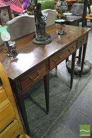 Sale 8390 - Lot 1046 - A Late Victorian Mahogany Side Table in the Georgian Manner fitted with three drawer and on tapering reeded legs.
