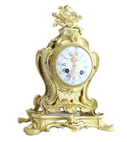 Sale 8960J - Lot 59 - Antique French 8 day rococo bell striking Gilt bronze mantle clock. Enamel porcelain dial with blue Roman numerals and pierced gilt...
