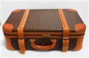 Sale 8312A - Lot 60 - A vintage French Louis Vuitton 'Stratos' suitcase, size 60 x 42 x 18 cm