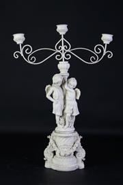 Sale 8905S - Lot 679 - A composite cherubic form three candle holder. Height 52cm