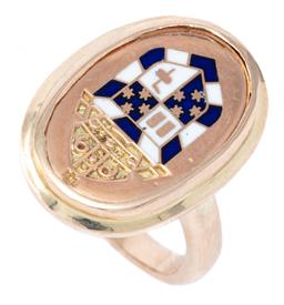 Sale 9107J - Lot 326 - A 9CT GOLD ENAMELLED SIGNET RING; featuring an engraved mitre above a shield inlaid with blue and white enamel, size H, top 21 x 15m...
