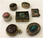 Sale 8436A - Lot 9 - A group of seven cabochon encrusted pill boxes.