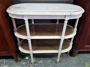 Sale 8617 - Lot 1018 - Louis XVI Style White Painted Etagere, with oval marble top & two caned panel shelves, on turned reeded supports