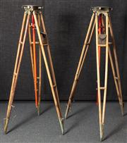 Sale 8984W - Lot 501 - A pair of large red timber surveyors stands with central pendulum and leather level pouch each height approx 150cm