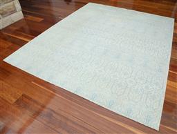 Sale 9134H - Lot 7 - A hand woven Indian Rasmah woollen Cadrys rug in blue and cream stylised geometrics, 247cm x 300cm