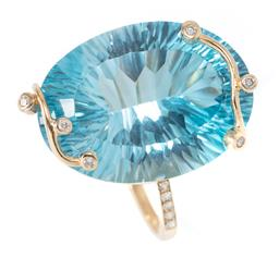 Sale 9246J - Lot 400 - A 9CT GOLD TOPAZ AND DIAMOND COCKTAIL RING; featuring a fancy oval cut blue topaz of approx. 25ct secured by branch claws set with 6...