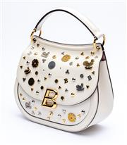 Sale 8921 - Lot 19 - A BALLY RARE BALLYUM WHITE LEATHER 2017 BADGE BAG; with gold tone B clasp and hardware, front attached with badges in gold, rose gol...