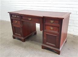 Sale 9126 - Lot 1072 - Late Victorian Walnut Desk, the slightly breakfront leather inset top, with five drawers below & two panel doors (h:74 w:134 d:64cm)