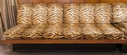 Sale 8313A - Lot 86 - A four seater retro lounge with tiger stripe upholstery, two cushions, length 182cm, depth 83cm