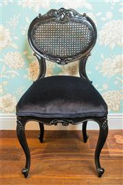 Sale 8500A - Lot 45 - A French provincial style black upholstered heart chair featuring rattan heart shaped backrest, black velvet coil sprung upholstered...