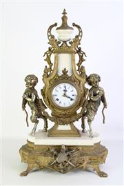 Sale 8905S - Lot 684 - A large and impressive cast metal clock decorated with cherubs together with two elaborate candle holder garnitures. Clock Height 6...
