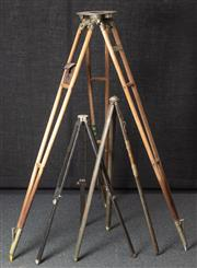 Sale 8984W - Lot 503 - A large surveyors tripod with leather level pouch together with an early military example and one other.
