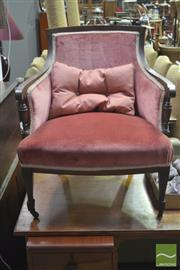 Sale 8317 - Lot 1094 - Late Victorian Mahogany Tub Chair, with raised back in pink velvet, raised on tapering legs with castors