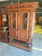 Sale 8868 - Lot 1164 - Late 19th German Oak Bookcase, in the renaissance manner, with deep cornice, above two glass panel doors, flanked by pilasters, rais...