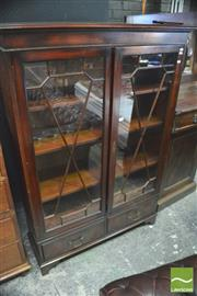 Sale 8390 - Lot 1021 - Georgian Style Dwarf Bookcase with two astragal doors inclosing adjustable shelves and two drawers below - H 150 x W 102 x D 53cm (K...