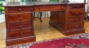 Sale 8435A - Lot 81 - A mahogany double pedestal partners desk with nine drawers to one side and three drawers and two doors to the other, W 180 x H 96 x...