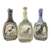 Sale 8911W - Lot 873 - 3x Jim Beam 8YO Kentucky Straight Bourbon Whiskey - James Lockhart decanter set of 3 (champion dogs)