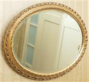Sale 8908H - Lot 11 - An oval bevelled edge gilt frame mirror, Width 70cm