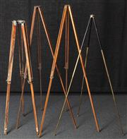 Sale 8984W - Lot 507 - A collection of four timber tripods and one metal example of slender form. Tallest 134cm