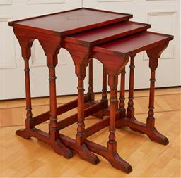 Sale 9098H - Lot 89 - A nest of three table with red leatherette tops, Tallest 66cm x 58cm x 38cm