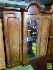 Sale 8539 - Lot 1094 - Victorian Figured Walnut Breakfront Wardrobe, with central arch & mirror panel door, flanked by two timber panel doors